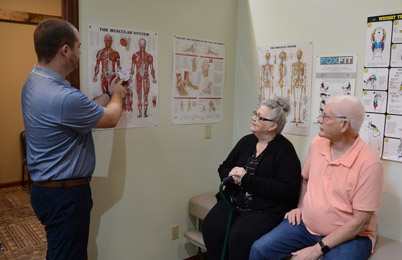 Chiropractor Bret Grimes Consulting Patients at LiveWell Chiropractic & Wellness Center